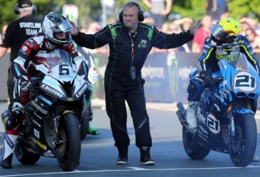 Lougher shares a joke with Michael Dunlop on the start line.