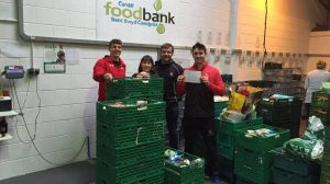 Chris Williams (black top) and Owen Clemett (right) donating to the foodbank.