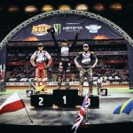 Maciej Janowski, Tai Woffinden, and Fredrik Lindgren finishing in podium positions at the 2018 Boll Warsaw FIM Speedway Grand Prix of Poland Round 1