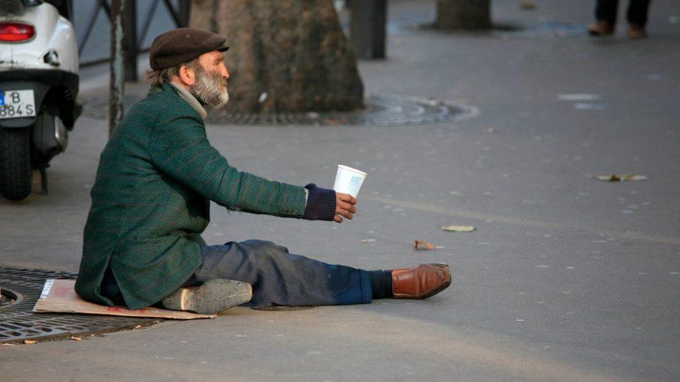 homeless man sitting on the street