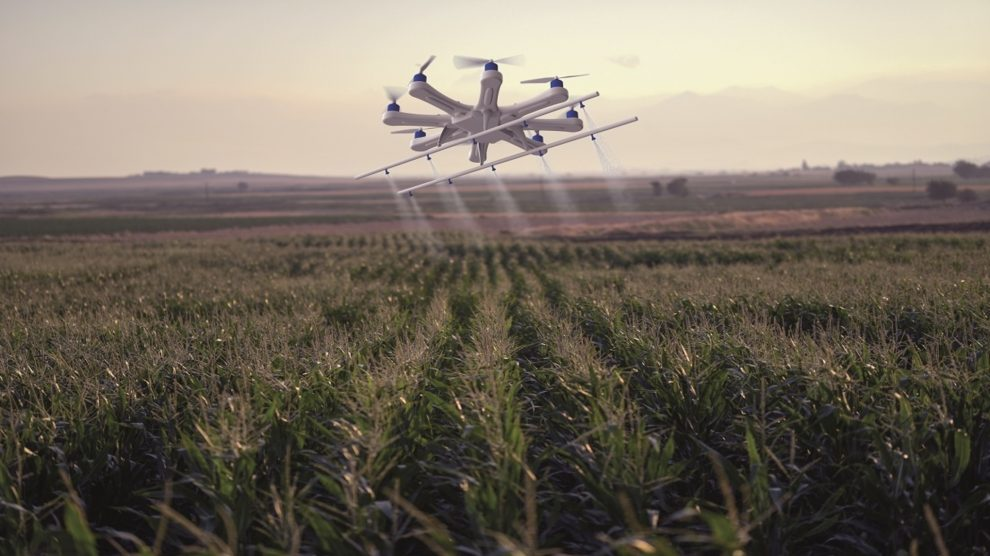 smart technology of drone flying over crop field