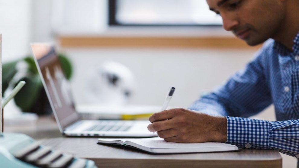 university student studying by laptop
