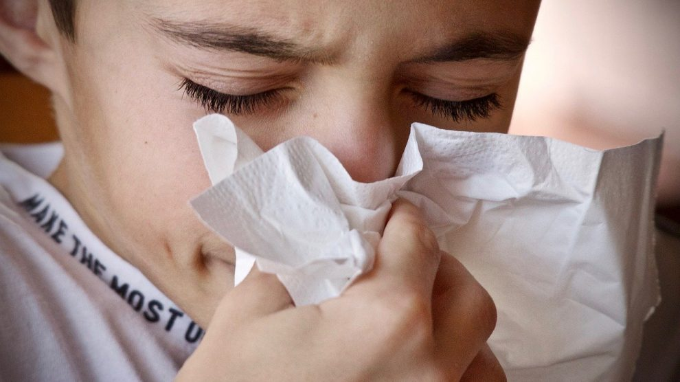 child sneezing with a cold