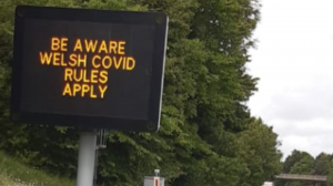 Sign on the A55 near Queensferry at border between Wales and England