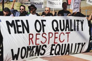 Image of men protesting: 'Men of Quality Respect Womens equality'. In this article the image can relate to the Sarah Everard case