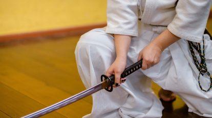 Image of person holding a samurai sword